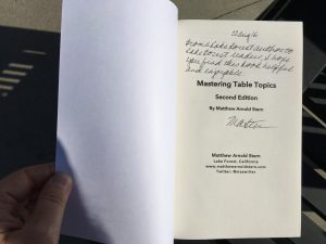 An autographed copy of Mastering Table Topics.