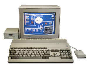 Amiga 500 with monitor and second floppy drive.